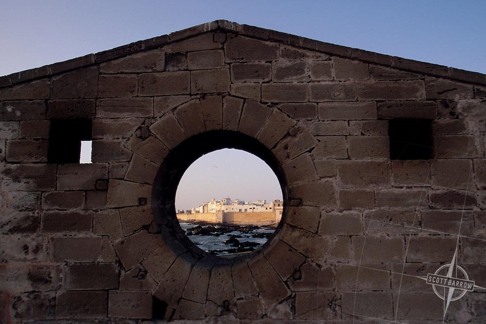 View of Port Sqala, Essaouira through a stone wall.