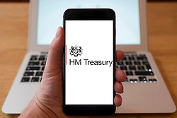 Using iPhone smartphone to display logo of HM Treasury, UK Government