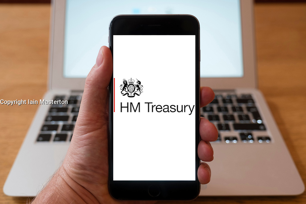 Using iPhone smartphone to display logo of HM Treasury, UK Government