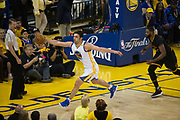 Golden State Warriors center Zaza Pachulia (27) saves the ball from going out of bounds during Game 5 of the NBA Finals against the Cleveland Cavaliers at Oracle Arena in Oakland, Calif., on June 12, 2017. (Stan Olszewski/Special to S.F. Examiner)
