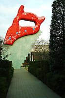 """""""Saw, Sawing"""" is a 46 ft tall sculpture which meets the rigorous earthquake and wind load requirements of the Japanese building code while maintaining the true proportions required by the artists.  Commissioned by the Tokyo Municipal Government this monumental sculpture was created by American artists Swedish-born Claes Oldenburg and Dutch-born Coosje van Bruggen."""