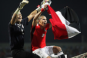 Egypt's Esam Kamal Tawfik El Hadary (left) and Mohamed Abdalla Mohamed Zidan celebrate as they sit atop the goal after defeating Cameroon to win the 2008 Africa Cup of Nations in Accra, Ghana.