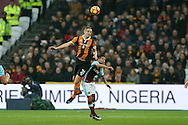 Michael Dawson of Hull City jumps over Manuel Lanzini of West Ham United to head the ball. Premier league match, West Ham Utd v Hull city at the London Stadium, Queen Elizabeth Olympic Park in London on Saturday 17th December 2016.<br /> pic by John Patrick Fletcher, Andrew Orchard sports photography.