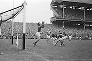 Kerry goalie J. Culloty grabs the ball from the air during the All Ireland Senior Gaelic Football final Kerry v. Galway in Croke Park on 27th September 1964.