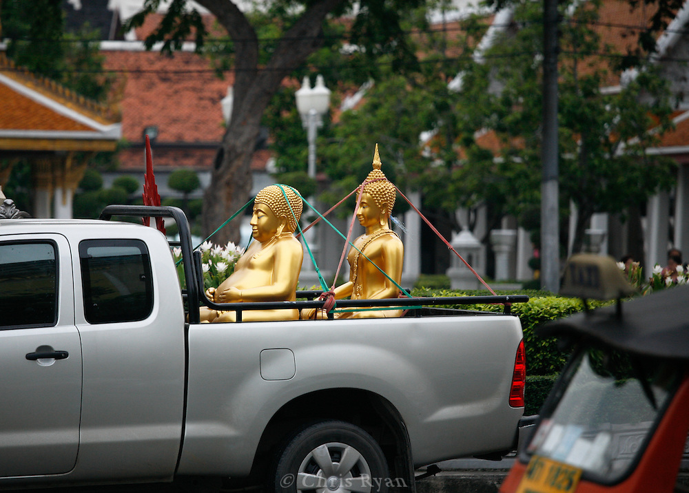 Buddha statues being transported in Bangkok.