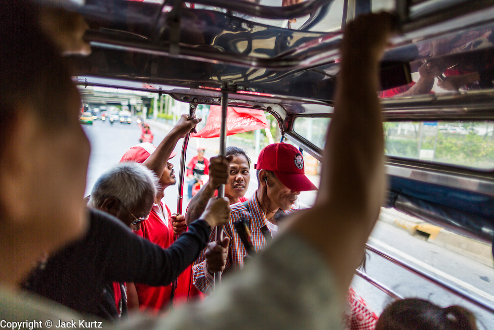 08 MAY 2013 - BANGKOK, THAILAND: Red Shirt protesters in a pickup truck going to the Thai parliament building in Bangkok. A splinter group of the Red Shirts, Thai supporters of exiled Prime Minister Thaksin Shinawatra, have besieged the Thai Constitutional Court for the last three weeks calling for the resignation of the justices, who have indicated they might oppose a proposed constitutional reform which would grant amnesty to people convicted of political crimes since 2007. This would probably include Thaksin. The justices have refused to step down. Wednesday the protesters moved their protest to the Thai Parliament, which is largely powerless to intervene.    PHOTO BY JACK KURTZ