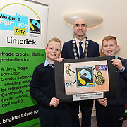 05/03/2019<br /> Winners of Fairtrade Poster competition announced.<br /> Pictured is Fairtrade poster competition winners  Cian Enright and Ronan Power, 5th class, Knockea NS, along with Cllr Daniel Butler, Mayor of the Metropolitan District of Limerick.<br /> <br /> Fairtrade worker Sara Montoya, from a Fairtrade Coffee Co-op in Colombia was the special guest in Limerick City and County Council chamber today at an event to coincide with Fairtrade Fortnight.<br />  <br /> Sara joined Fairtrade supporters from across Limerick and Ireland for the annual initiative, which features a programme of talks and community events aimed at promoting awareness of Fairtrade and Fairtrade-certified products.<br />  <br /> Speaking at the event in Dooradoyle, Sara outlined the success and benefits of the Fairtrade movement in Colombia and how important it is for people in the developed world think of Fairtrade products when shopping.<br />  <br /> This year's campaign 'Create Fairtrade' invites us all to use our imagination and create fairtrade in our lives.<br />  <br /> Young people from across Limerick city and county were also a focus of the event as they displayed their posters, which they created to help change the way people think about trade and the products on our shelves.<br /> Photo by Diarmuid Greene
