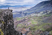 Photographers in top cliff of Haifoss waterfall, South Iceland