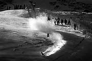 (SANTA CATERINA, Italy - Shot 2/2/2005)<br /> U.S. women's downhiller and Vail, CO native Lindsey C. Kildow (#16) kicks up snow as she carves through a set of gates during training on Wednesday on the Pista Deborah Compagnoni slope. The second of three training runs was held Wednesday in Santa Caterina on the Pista Deborah Compagnoni slope in Santa Caterina, Italy in preparation for Sunday's women's downhill at the FIS Alpine World Ski Championships.