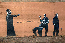 08 August 2015. New Orleans, Louisiana.<br /> A Banksy look-a-like graffiti on the wall at the Alfred C Priestley Junior High School in Pigeon Town.The last students and teachers left the building in 1980.<br /> Photo; Charlie Varley/varleypix.com