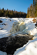 Brule River and Devil's Kettle Falls on a cold winter day; Judge CR Magney State Park, Grand Marais, Minnesota, USA.