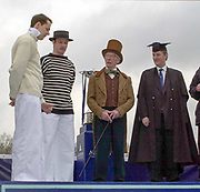 Putney. London.  2004 University Boat Race,  Championships Course, Putney to Mortlake. <br /> Re enactment of the toss, Cambridge and Oxford presidents act iy out over seen by Christopher DAVAGE [Top Hat] and AN OTHER<br /> <br /> [Mandatory Credit Peter SPURRIER]