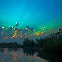 A sunset glows over a pond near Bozeman, Montana.