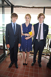 Left to right, LORD SETTRINGTON, CLEMMIE GIBBS and RUPERT GIBBS at the 3rd day of the 2009 Glorious Goodwood racing festival held at Goodwood Racecourse, West Sussex on 30th July 2009.