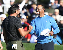 January 26, 2017 - San Diego, California, United States - Tiger Woods shakes hands with Jason Day (L) after he birdies the 18th green during the first round of the Farmers Insurance Open at Torrey Pines GC. (Credit Image: © Debby Wong via ZUMA Wire)