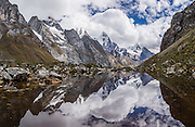 Mount Jirishanca (Icy Beak of the Hummingbird, 6126 m or 20,098 feet) reflects in a stream pond in the Cordillera Huayhuash, Andes Mountains, Peru, South America. Day 3 of 9 days trekking around the Cordillera Huayhuash. This panorama was stitched from 4 overlapping photos.