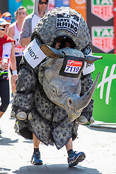 © Licensed to London News Pictures. 22/04/2018. London, UK. A runner dressed as a rhino passes the Cutty Sark in Greenwich during the Virgin Money London Marathon 2018. Photo credit: Rob Pinney/LNP