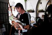 KRAKAU, POLAND - 15/07/2005 - Father carrying his daughter on the streets of Krakau..© Christophe VANDER EECKEN