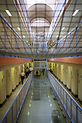 Suicide netting on C wing inside HM Prison Wandsworth is a Category B men's prison at Wandsworth in the London Borough of Wandsworth, South West London, United Kingdom. It is operated by Her Majesty's Prison Service and is one of the largest prisons in the UK with a population over 1500 people. (photo by Andy Aitchison)