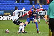 Crystal Palace Midfielder, Jordon Mutch (22) and Bolton Wanderers Defender, Andrew Taylor (20) during the The FA Cup 3rd round match between Bolton Wanderers and Crystal Palace at the Macron Stadium, Bolton, England on 7 January 2017. Photo by Mark Pollitt.