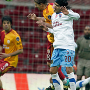 Galatasaray's Ayhan AKMAN (C) and Trabzonspor's Gustavo COLMAN (R) during their Turkish superleague soccer derby match Galatasaray between Trabzonspor at the TT Arena in Istanbul Turkey on Sunday, 10 April 2011. Photo by TURKPIX