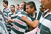 25 DECEMBER 2003 - PHOENIX, AZ: Bishop Thomas Olmsted, of the Roman Catholic Church's Phoenix Diocese, leads Christmas mask in the Maricopa County Jail in Phoenix, AZ. In 2011, the US Department of Justice issued a report highly critical of the Maricopa County Sheriff's Department and the jails. The DOJ said the Sheriff's Dept. engages in widespread discrimination against Latinos during traffic stops and immigration enforcement, violates the rights of Spanish speaking prisoners in the jails and retaliates against the Sheriff's political opponents.    PHOTO BY JACK KURTZ