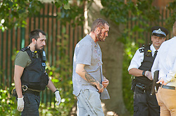 ©Licensed to London News Pictures 26/06/2020<br /> Orpington, UK. A man at the scene bleeding from head wounds. Coronavirus lockdown is over and crime is back on our streets. A gang of six youths on bikes have attacked a man in Orpington,South East London this afternoon. Police, paramedics and the London Air Ambulance attended the scene to find a man with head injuries and covered in blood. Photo credit: Grant Falvey/LNP