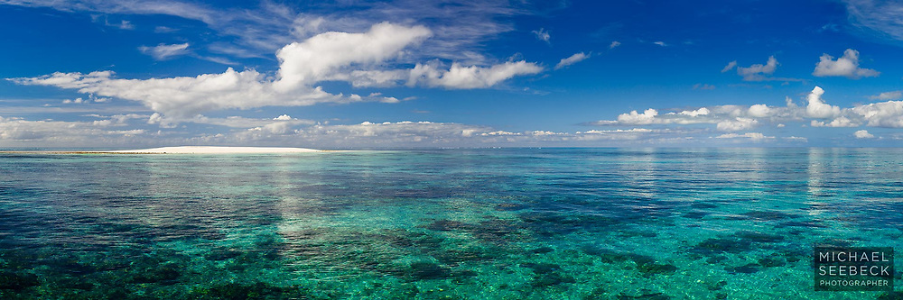 The aqua blue waters over coral reefs surrounding Vlasoff Cay on the Great Barrier Reef.<br /> <br /> Limited Edition Print