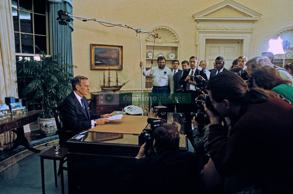 United States President George H.W. Bush poses for photos in the Oval Office of the White House in Washington, D.C. after announcing the start of the air offensive to liberate Kuwait after it was overrun by Iraq on January 16, 1991. Photo by Ron Sachs / CNP /ABACAPRESS.COM