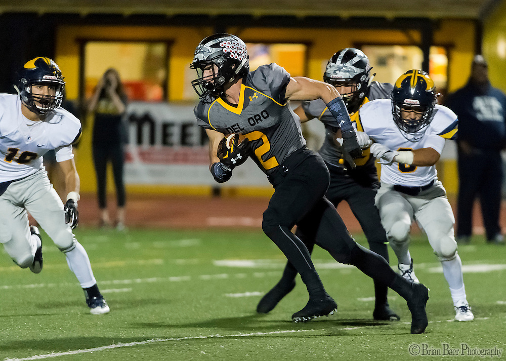 Del Oro Golden Eagle's Mason Hurst (2), catches the ball and runs for a touchdown to trail 21-18 after the point after attempt was good during the third quarter as the Del Oro Golden Eagles varsity football team host the Oak Ridge Trojans, Friday Oct 21, 2016.<br /> photo by Brian Baer