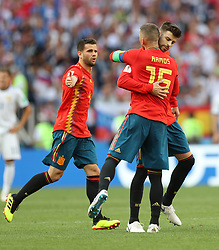 MOSCOW, July 1, 2018  Sergio Ramos (C) and Gerard Pique (R) of Spain celebrate after Russia's Sergey Ignashevich scored an own goal during the 2018 FIFA World Cup round of 16 match between Spain and Russia in Moscow, Russia, July 1, 2018. (Credit Image: © Xu Zijian/Xinhua via ZUMA Wire)