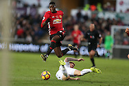 Paul Pogba of Manchester Utd jumps over a tackle from Alfie Mawson of Swansea city.  Premier league match, Swansea city v Manchester Utd at the Liberty Stadium in Swansea, South Wales on Sunday 6th November 2016.<br /> pic by  Andrew Orchard, Andrew Orchard sports photography.