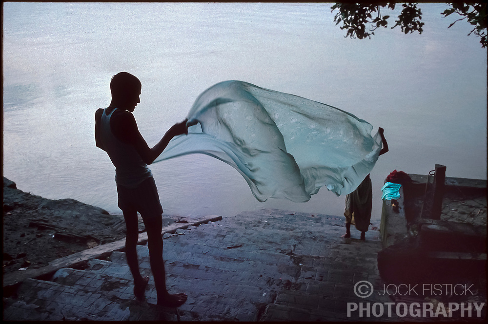 CALCUTTA, INDIA - The Hooghly River in Calcutta, India is an intricate part of daily life for city dwellers. It serves as a source for food, transportation, a bathroom and a place to do the family laundry. It is also a source of much disease. (Photo © Jock Fistick