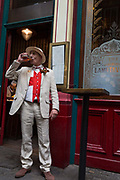 A lunchtime drinker enjoys a pint at a pub in Leadenhall Market in the capitals financial district aka The Square Mile, on 23rd April, City of London, England.