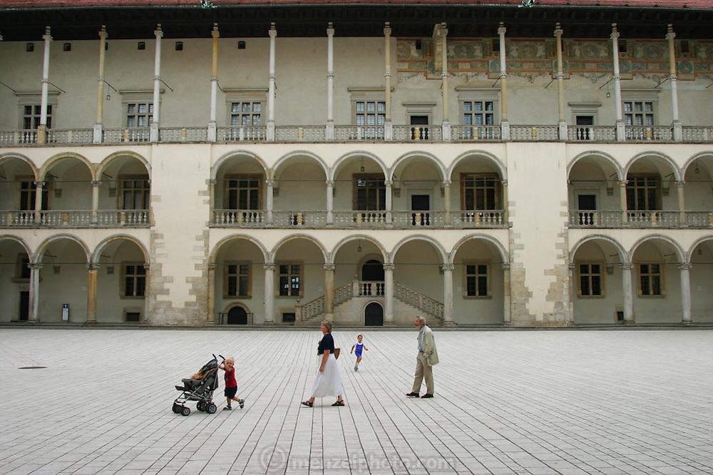 Family in Wawel Castle courtyard, Krakow, Poland.