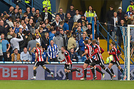 Sheffield United midfielder Mark Duffy (21) scores and celebrates in front on the wednesday fans 2-3 during the EFL Sky Bet Championship match between Sheffield Wednesday and Sheffield Utd at Hillsborough, Sheffield, England on 24 September 2017. Photo by Adam Rivers.