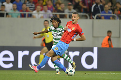 August 23, 2017 - Bucharest, Romania - Sporting's Gelson Martins and Steaua's Marko Momcilovic  during the UEFA Champions League play-offs 2nd leg football match between FC Steaua Bucharest and Sporting Lisbon at the National Arena Stadium, in Bucharest, Romania on August 23, 2017. (Credit Image: © Alex Nicodim/NurPhoto via ZUMA Press)
