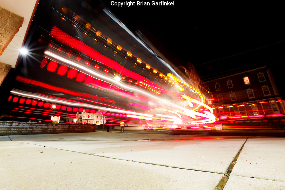 Clifton Heights, Pennsylvania - A Fire Truck backs into a fire station with its emergency lights flashing at night.