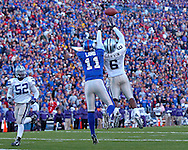 Kansas State defensive back Byron Garvin (6) intercepts a Kerry Meier pass in front of Kansas wide receiver Jonathan Lamb (11) in the first half at Memorial Stadium in Lawrence, Kansas, November 18, 2006.  Kansas beat K-State 39-20.<br />