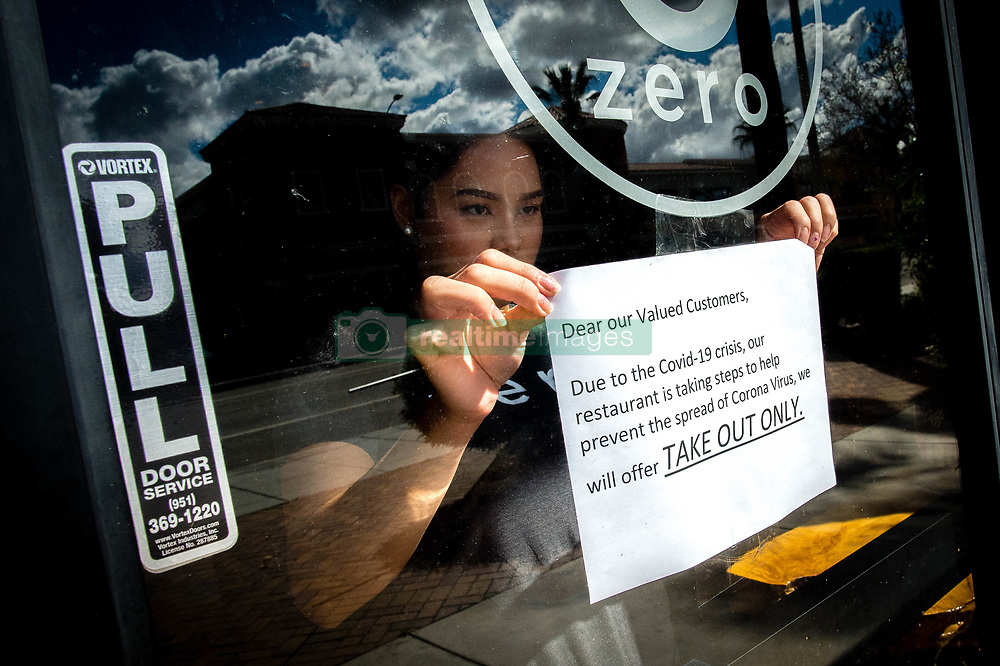 March 17, 2020, Riverside, California, USA: Supervisor KRYZTEL NATIVIDAD posts a notice on the door of Zero X, a coffee and tea cafe, in Riverside on Tuesday, notifying customers of disrupted the service due to outbreak of novel coronavirus (COVID-19). The City of Riverside ordered the temporary closure of dine-in services for restaurants, with only to drive-though or other pick-up/delivery options. (Credit Image: © Watchara Phomicinda/Orange County Register via ZUMA Wire)