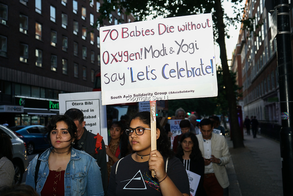 London, England, UK. 15th August 2017. today's is the 70th anniversary of India's Independence, March Against Mob Lynching in India to India Embassy against Hindu supremacist Brahmanical ideology. An execution, a Protester holding a placard written of 70 babies without Oxygen -Modi -Yogi. Protesters allege Narendra Modi, Prime Minister of India supporting Hindu supremacist Brahmanical ideology.