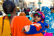 Indian woman and child in street scene in holy city of Varanasi, Benares, Northern India