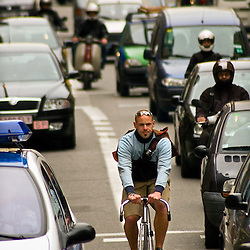 Bike messengers are fairly new to Barcelona and traffic is not always sure how to react to bikes riding so close.
