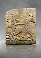 Hittite relief sculpted orthostat stone panel of Long Wall Limestone, Karkamıs, (Kargamıs), Carchemish (Karkemish), 900 - 700 B.C. Chariot. Anatolian Civilisations Museum, Ankara, Turkey<br /> <br /> One of the two figures in the chariot holds the horse's headstall while the other throws arrows. There is a naked enemy with an arrow in his hip lying face down under the horse's feet It is thought that this figure is depicted smaller than the other figures since it is an enemy soldier. The lower part of the orthostat is decorated with braiding motifs. <br /> <br /> On a grey art background. .<br />  <br /> If you prefer to buy from our ALAMY STOCK LIBRARY page at https://www.alamy.com/portfolio/paul-williams-funkystock/hittite-art-antiquities.html  - Type  Karkamıs in LOWER SEARCH WITHIN GALLERY box. Refine search by adding background colour, place, museum etc.<br /> <br /> Visit our HITTITE PHOTO COLLECTIONS for more photos to download or buy as wall art prints https://funkystock.photoshelter.com/gallery-collection/The-Hittites-Art-Artefacts-Antiquities-Historic-Sites-Pictures-Images-of/C0000NUBSMhSc3Oo