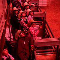 Cowboys watching the firework show during intermission at the Wild Thing 25th Annual Championship Bull Riding competion at Red Rock Park, July 14.