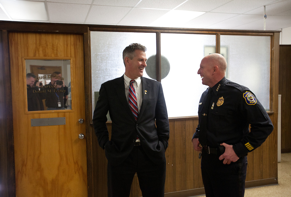 Waltham, MA 03/30/2012.Senator Scott Brown (R-MA) shares a laugh with Waltham Police Chief Thomas LaCroix during a tour of the police station on Friday afternoon.