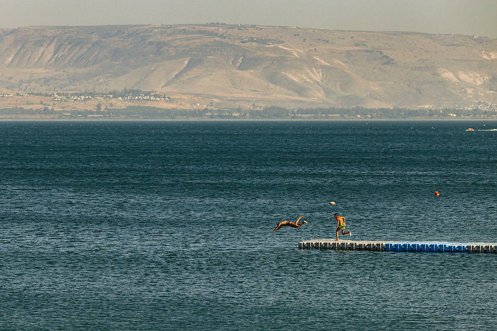 Children plunge into the Sea of Galilee (Kinneret in Hebrew) in northern Israel