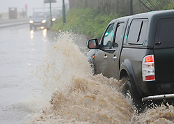 © Licensed to London News Pictures. 30/05/2013<br /> <br /> Saltburn, Cleveland, United Kingdom<br /> <br /> A car driver makes his way through deep floods as heavy overnight rain causes flooding in Saltburn on the A174 coast road near to the Ship Inn on the seafront in the town.<br /> <br /> Photo credit : Ian Forsyth/LNP
