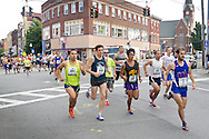 Middletown, New York - Female runners take off at the start of  the Orange Regional Medical Center's Run 4 Downtown road race on Aug. 16, 2014. All the proceeds from the Run 4 Downtown go to revitalizing Middletown's Historic district.