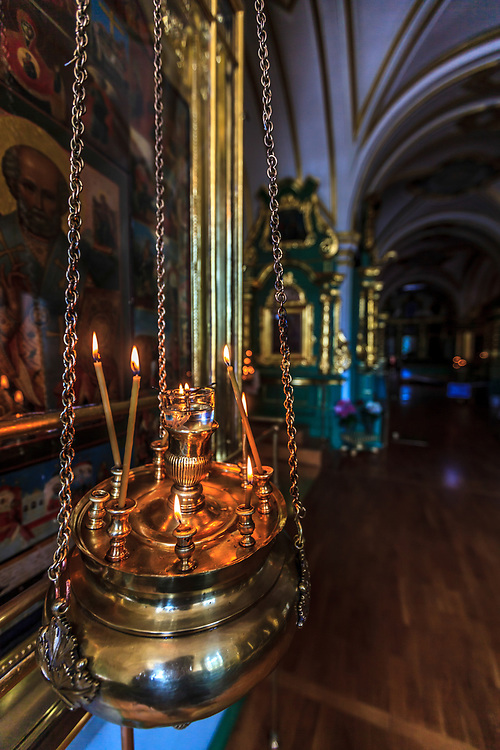 Incense candles in Naval Cathedral of St. Nicholas in St Petersburg, Russia. The cathedral houses ten spectacular icons in gold frame that were a gift from Catherine the Great.